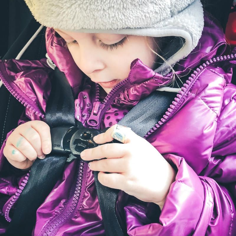 FINALLY!  A coat that keeps your kiddo warm (and safe) in the car seat